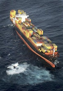 The Liberian-flagged container ship MV Rena is stuck hard aground on a reef 12 nautical miles off the coast of Tauranga, New Zealand, Wednesday, Oct. 5, 2011, after striking the reef early in the morning. The 236 meter (774 feet) long ship has 1,700 tonnes of fuel oil and 2,100 shipping containers on board as it sits on the reef at a 10-degree list.
