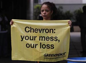 Greenpeace activists protested outside Chevron's offices in Rio de Janeiro, Brazil, on Friday. Photo credit Silvia Izquierdo/ AP.