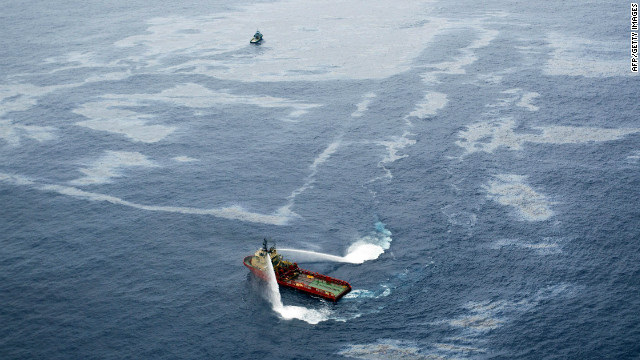 Boats work to disperse an oil spill northeast of Rio de Janeiro in November.