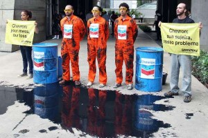 Greenpeace activists in Rio de Janiero protest an oil spill by Chevron last month. The company has been hit with major fines, which could chill foreign investment in the Brazilian oil industry.