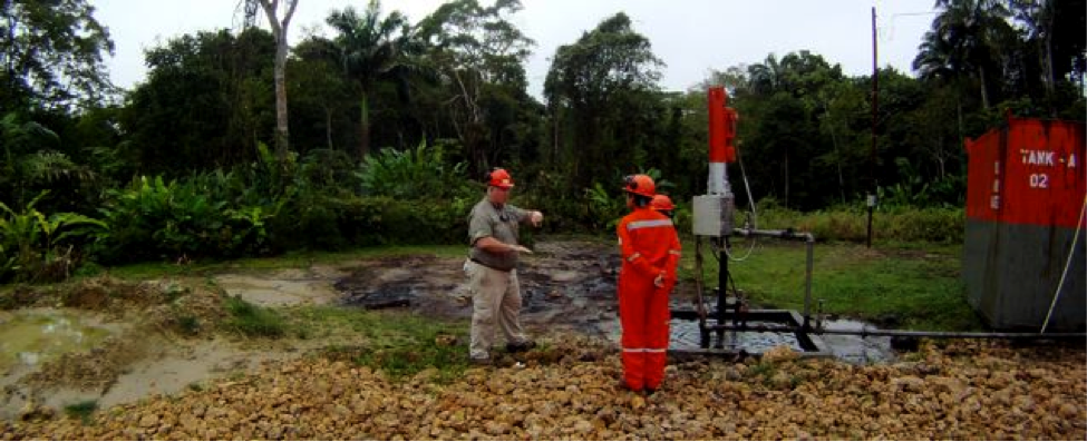 Workers for Trinidad Fuel & Oil Services get ready to set the grid and take core samples prior to applying DE-OIL-IT. The petroleum penetration is well over 100 deep and cleanup is expected to take 2 months.
