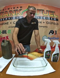 Crude oil is added to a clear glass dish to show how DE-OIL-IT is a cleaner, degreaser, and degrader.