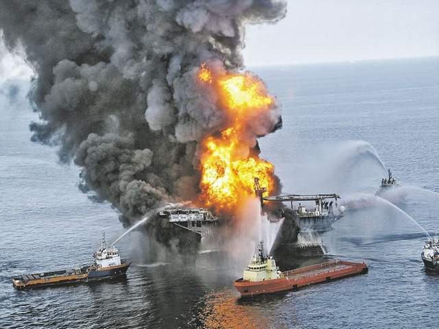 BP oil spill settlement: Flames shoot up from the Deepwater Horizon in 2010. AP file photo
